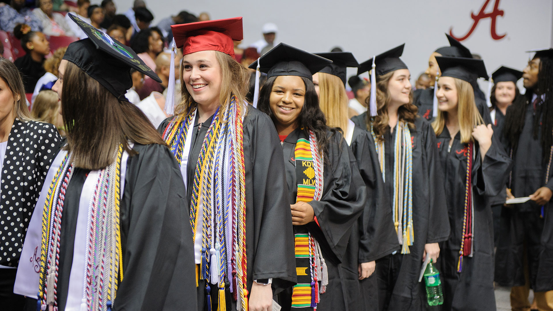graduates standing in line to be seated during the commencement opening ceremony.