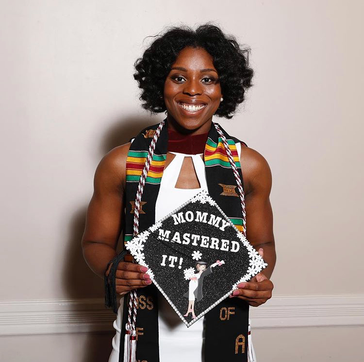 A female grad shows off her decorated mortar board