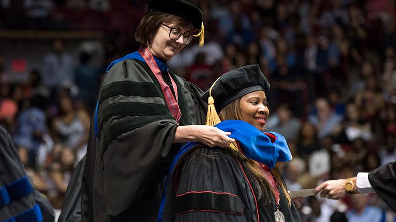 Adora Hicks receiveing her doctoral degree.
