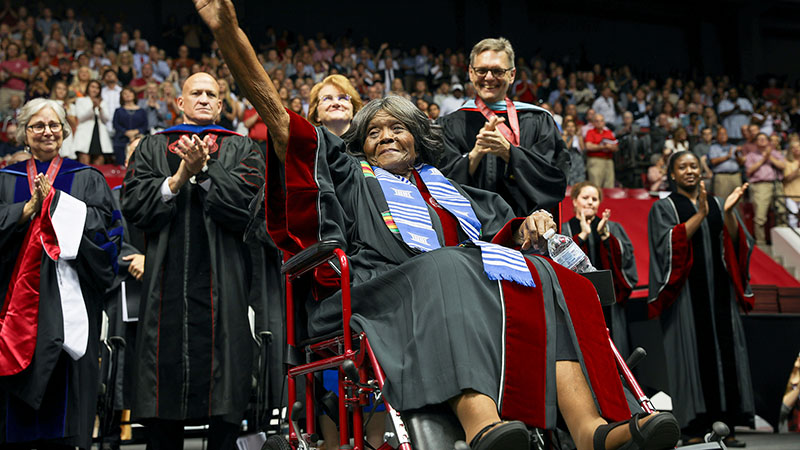 Autherine Lucy Foster waves to a standing ovation.