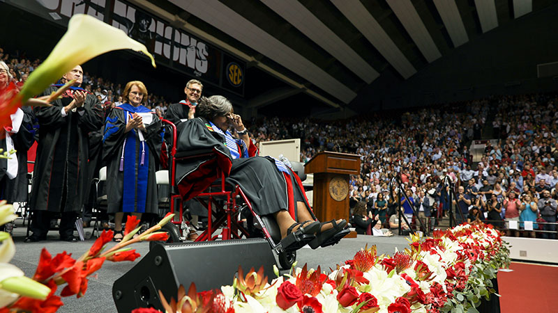 Autherine Lucy Foster accepting her degree from Dr. Bell to a standing ovation.